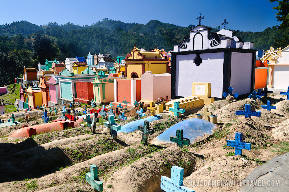 The colorful headstones and markers of Chichicastengo's cemetery. It serves as both a Maya and Catholic cemetery. Chichicastenango is an indigenous Maya town in the Guatemalan highlands about 90 miles northwest of Guatemala City and at an elevation of nearly 6,500 feet. It is most famous for its markets on Sundays and Thursdays.