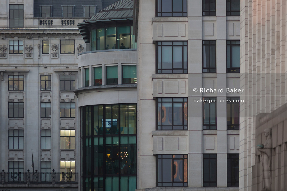 The House of Fraser department store (left) and a business meeting on the top floor of corporate offices in late afternoon in the heart of the Square Mile, the capital's historical and financial centre, on 1st November 2017, in the City of London, England.