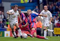 Photo: Daniel Hambury.<br />Crystal Palace v Leeds United. Coca Cola Championship. 13/08/2006.<br />Palace's James Scowcroft despite the attention of Leeds' Paul Butler.