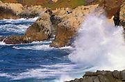 Crashing waves and rough surf along rocky shoreline on the Big Sur Coast, California