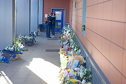 ©Licensed to London News Pictures 26/09/2020  <br /> Croydon, UK. Colleagues hug surrounded by flowers for Sgt Matt Ratana at Croydon Custody Centre this morning. A murder investigation has been launched by police after the death of  custody police sergeant Matt Ratana at the Croydon Custody Centre in South London yesterday.Photo credit:Grant Falvey/LNP