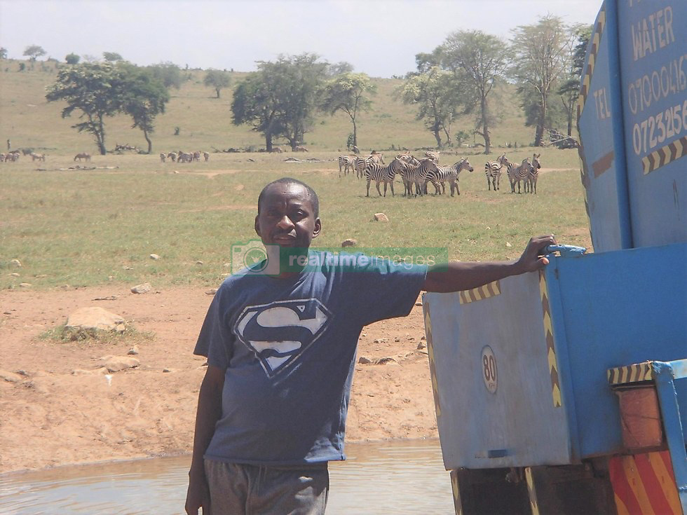 In a land as parched as Kenya's Tsavo West National Park, no visitor arrives with more fanfare than the water man...That would be Patrick Kilonzo Mwalua. And when he rumbles down the dusty road bearing some 3,000 gallons of fresh water, the elephants, buffalo, antelope and zebras come running...They've come to know the water man by the rumble of his engine. And his lifesaving cargo. ''There is completely no water, so the animals are depending on humans,'' Mwalua said,. ''If we don't help them, they will die.'' Mwalua fills the bone-dry watering holes in the region, driving for hours on end every day to haul water to where it's most desperately needed...The holes themselves, lined with concrete, often need cleaning — Mwalua blames it on buffalo droppings — and sometimes, he will just hose down an area of cracked earth for the grateful animals...''The buffalo roll in the mud so they suffocate the fleas and ticks,'' he says. Many animals don't even wait that long, fearlessly crowding the truck as Mwalua cranks the tap...''Last night, I found 500 buffalo waiting at the water hole,'' he says. ''When I arrived they could smell the water. The buffalo were so keen and coming close to us...''They started drinking water while I was standing there. They get so excited.'' Mwalua, who is a pea farmer in his local village, came up with the idea after seeing firsthand the grim toll climate change has taken in his native land. In the last year especially, he says, the area has seen precious little precipitation, leaving animals to die of thirst in these cracked lands...''We aren't really receiving rain the way we used to,'' he says. ''From last year, from June, there was no rain completely. So I started giving animals water because I thought, 'If I don't do that, they will die.''' Between road trips, Mwalua runs a conservation project called Tsavo Volunteers. The 41-year-old also visits local schools to talk to children about the wildlife that is their legacy...''I wa