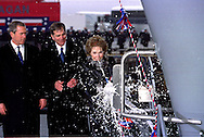 A 17.3 MG FILE FROM FILM OF:..Nancy Reagan Christening the Aircraft Carrier Ronald Reagan at the Newport News  Shipyard.  Presdient GW Bush and William P Fricks CEO Newsport News Shipbuilding look on. Photo by Dennis Brack