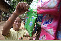 Keansy 54 years old is a member of the Older People's Group. She helps look after the shop of her sister in Law which stocks everyday items needed by villagers.<br /> Had Khen Village, Pakseng District, Luang Prabang Province, Lao PDR