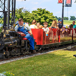 Strasburg, PA - July 19, 2016: Visitors ride on a small, working steam train at the Strasburg Rail Road.