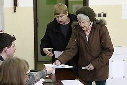 Voters register their personal information at a polling station in Bratislava, Slovakia, March 5, 2016. The ninth general election in Slovakia's history kicked off at 7 a.m. local time (0600 GMT) Saturday, with some 4.4 million eligible voters expected to cast their vote in 5,992 polling stations nationwide for the 150-member parliament. EXPA Pictures © 2016, PhotoCredit: EXPA/ Photoshot/ Andrej Klizan<br /><br />*****ATTENTION - for AUT, SLO, CRO, SRB, BIH, MAZ, SUI only*****