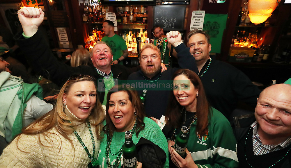 Andy O'Sullivan (right) from Killarney and his family celebrate Ireland's Grand Slam victory at the Pig and Whistle Irish pub in New York City.
