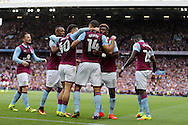 Rudy Gestede of Aston Villa (14) celebrates with his teammates after he scores his teams 1st goal.EFL Skybet championship match, Aston Villa v Rotherham Utd at Villa Park in Birmingham, The Midlands on Saturday 13th August 2016.<br /> pic by Andrew Orchard, Andrew Orchard sports photography.