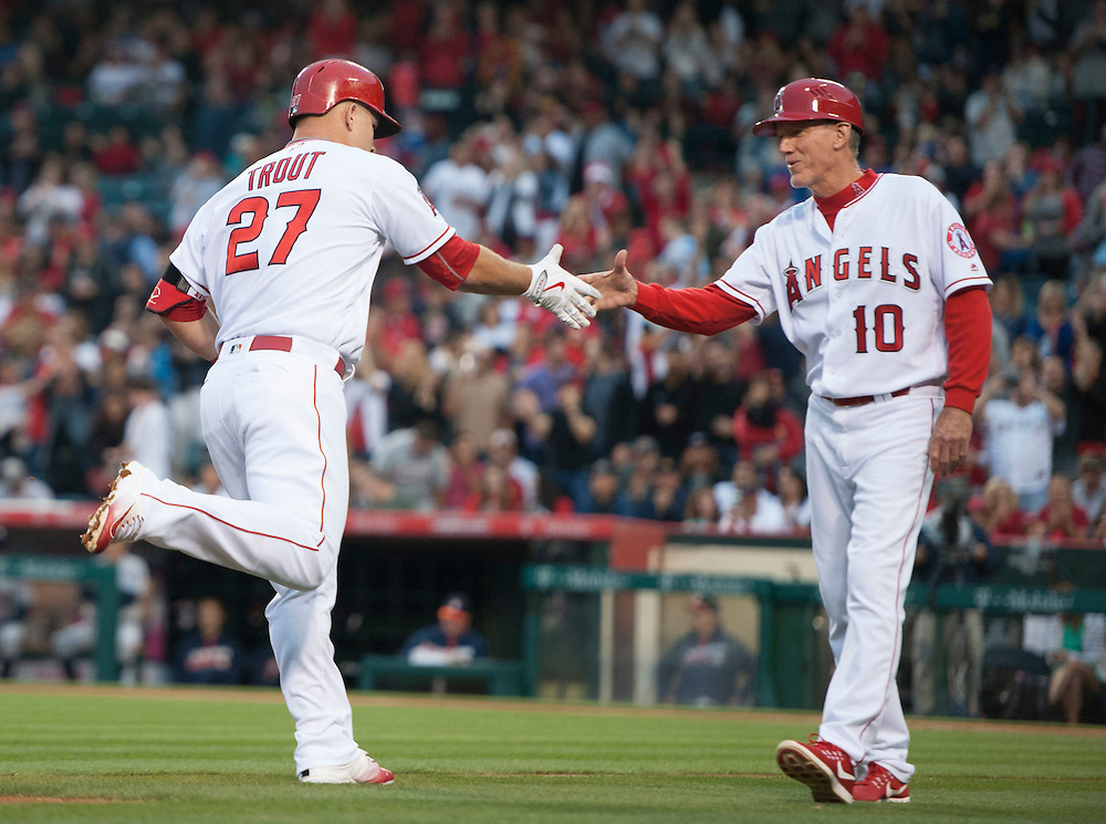 Mike Trout shakes hands with third base coach Ron Roenicke after his solo home run in the first inning against the Houston Astros Saturday at Angel Stadium.<br /> <br /> ///ADDITIONAL INFO:   <br /> <br /> angels.0529.kjs  ---  Photo by KEVIN SULLIVAN / Orange County Register  -- 5/28/16<br /> <br /> The Los Angeles Angels take on the Houston Astros Saturday at Angel Stadium.