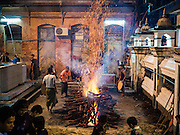 20 OCTOBER 2015 - YANGON, MYANMAR: Firetenders set up the fire before firewalking at Punja Mosque in Yangon. Ashura commemorates the death of Hussein ibn Ali, the grandson of the Prophet Muhammed, in the 7th century. Hussein ibn Ali is considered by Shia Muslims to be the third imam and the rightful successor of Muhammed. He was killed at the Battle of Karbala in 610 CE on the 10th day of Muharram, the first month of the Islamic calendar. According to Myanmar government statistics, only about 4% of the population is Muslim. Many Muslims have fled Myanmar in recent years because of violence directed against Burmese Muslims by Buddhist nationalists.   PHOTO BY JACK KURTZ