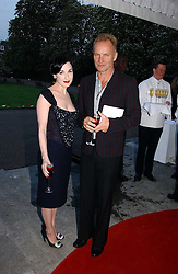 Singer STING and DITA VON TEESE at a party to celebrate the opening of Roger Vivier in London held at The Orangery, Kensington Palace, London on 10th May 2006.<br />