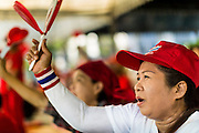 08 MAY 2013 - BANGKOK, THAILAND:  A Thai Red Shirt uses her noise maker to applaud Red Shirt speakers during a protest at the constitutional court. A splinter group of the Red Shirts, Thai supporters of exiled Prime Minister Thaksin Shinawatra, have besieged the Thai Constitutional Court for the last three weeks calling for the resignation of the justices, who have indicated they might oppose a proposed constitutional reform which would grant amnesty to people convicted of political crimes since 2007. This would probably include Thaksin. The justices have refused to step down. Wednesday the protesters moved their protest to the Thai Parliament, which is largely powerless to intervene.  PHOTO BY JACK KURTZ