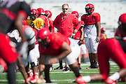 """Cedar Hill High School football coach Joey McGuire wears his Under Armour gear during football practice in Cedar Hill, Texas on August 24, 2016. """"CREDIT: Cooper Neill for The Wall Street Journal""""<br /> TX HS Football sponsorships"""