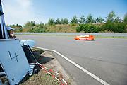Een deelnemer aan de 24-uursrace. In Duitsland worden op de Dekrabaan bij Schipkau recordpogingen gedaan met speciale ligfietsen tijdens een speciaal recordweekend.<br /> <br /> A competitor at the 24-hours race. In Germany at the Dekra track near Schipkau cyclists try to set new speed records with special recumbents bikes at a special record weekend.