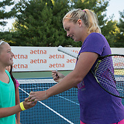 August 19, 2014, New Haven, CT:<br /> Coco Vandeweghe signs autographs during a Girl Scout Night clinic on day five of the 2014 Connecticut Open at the Yale University Tennis Center in New Haven, Connecticut Tuesday, August 19, 2014.<br /> (Photo by Billie Weiss/Connecticut Open)