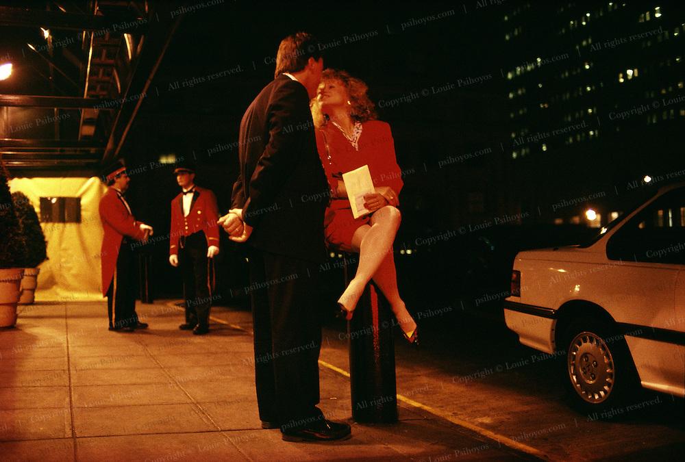 Couple kissing outside the Grand Hyatt Hotel in New York.