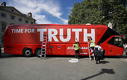"""© Licensed to London News Pictures. 18/07/2016. London, UK. A bus used by the Leave campaign during the EU referendum, rebranded by Greenpeace outside the Houses of Parliament in London. The """"Brexit Bus"""" was previously covered in a slogan claiming that £350 million sent to the EU could be spent on the NHS.  Photo credit: Peter Macdiarmid/LNP"""