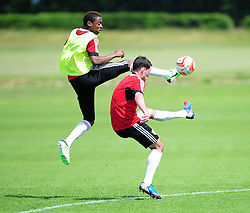 Kevin Krans challenges for the high ball with Gregg Cunningham - Photo mandatory by-line: Dougie Allward/JMP - Tel: Mobile: 07966 386802 28/06/2013 - SPORT - FOOTBALL - Bristol -  Bristol City - Pre Season Training - Npower League One