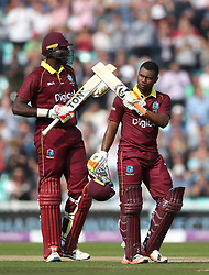 West Indies' Evin Lewis (right) celebrates his century during the Fourth Royal London One Day International at the Kia Oval, London.