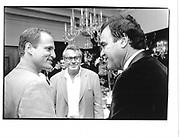 Woody Hamelson, Milos Farema, Oliver Stone Wasington 1992 approx© Copyright Photograph by Dafydd Jones 66 Stockwell Park Rd. London SW9 0DA Tel 020 7733 0108 www.dafjones.com