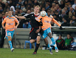 MARSEILLE, FRANCE - Tuesday, December 11, 2007: Liverpool's Dirk Kuyt and Olympique de Marseille's Jacques Faty during the final UEFA Champions League Group A match at the Stade Velodrome. (Photo by David Rawcliffe/Propaganda)