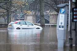 © Licensed to London News Pictures. 07/12/2015. York UK. Picture shows an abandoned car in York, the city has flooded for the second time this month after the river Ouse burst it banks last night with the after effects of Storm Desmond. Photo credit: Andrew McCaren/LNP