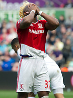 Football - 2016 / 2017 Premier League - Swansea City vs. Middlesbrough<br /> <br /> Adama Traoré of Middlesbroughholds his head after missing a shot at goal , at The Liberty Stadium.<br /> <br /> COLORSPORT/WINSTON BYNORTH