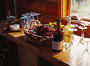 Fine wine, grapes and cheese ready for appetizers, Winterlake Lodge, Finger Lake, Alaska.