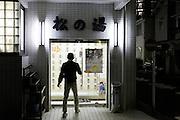 person entering a public bathhouse Japan