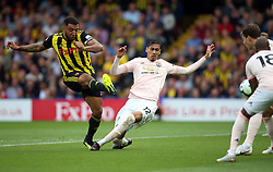 Watford's Troy Deeney (left) shots towards goal during the Premier League match at Vicarage Road, Watford