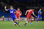 Christophe Berra of Ipswich Town tries to break away from Cardiff's Adam Le Fondre. Skybet football league championship match, Cardiff city v Ipswich Town at the Cardiff city stadium in Cardiff, South Wales on Tuesday 21st October 2014<br /> pic by Andrew Orchard, Andrew Orchard sports photography.