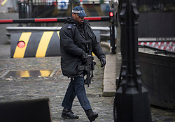 © Licensed to London News Pictures. 13/02/2018. London, UK. Armed police at the scene at Parliament where it is being reported that an incident is ongoing involving a suspect package.  Photo credit: Ben Cawthra/LNP