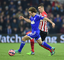 Ipswich Town's Stephen Hunt keeps the ball away from Southampton's Morgan Schneiderlin - Photo mandatory by-line: Paul Knight/JMP - Mobile: 07966 386802 - 04/01/2015 - SPORT - Football - Southampton - St Mary's Stadium - Southampton v Ipswich Town - FA Cup Third Round