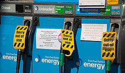 © Licensed to London News Pictures. 28/03/2012. London, England.  Three out of use fuel pumps at a North London Esso Station as a possible petrol tanker drivers strike looms. Photo credit: Bettina Strenske/LNP