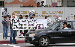May 10, 2017 - Los Angeles, California, U.S - Members of Refuse Fascism protest the Tuesday firing of FBI director James Comey by President Donald Trump, outside the downtown Los Angeles federal building Wednesday, May 10, 2017. (Credit Image: © Ringo Chiu via ZUMA Wire)