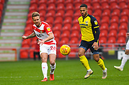 James Coppinger of Doncaster Rovers (26) drops the ball off the Jordan Clarke of Scunthorpe United (2) at his back during the EFL Sky Bet League 1 match between Doncaster Rovers and Scunthorpe United at the Keepmoat Stadium, Doncaster, England on 15 December 2018.