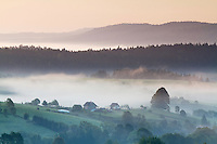Foggy September sunrise over the forests around the village of Lutowiska, Bieszczady National Park, Poland.