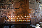 Flames of votive candles for prayer inside Iona Abbey ancient monument on Isle of Iona in the Inner Hebrides and Western Isles, Scotland