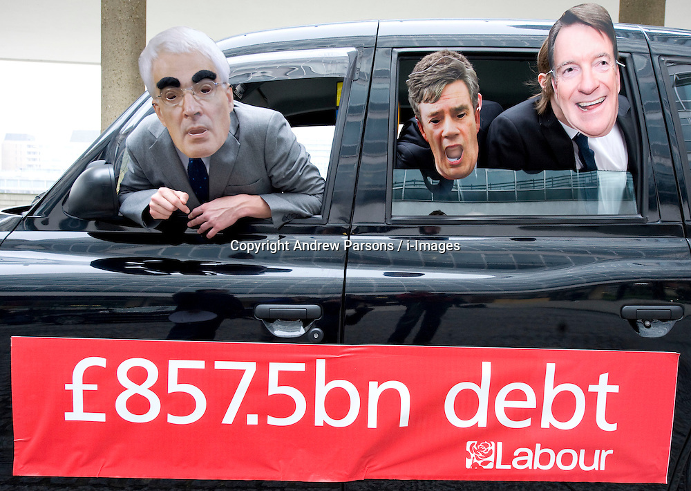 People posing as cabinet minsters in a London Taxi in Central London on Budget Day, highlighting Labour's £857.5bn Debt, Wednesday March 24, 2010.  Photo By Andrew Parsons / i-Images.