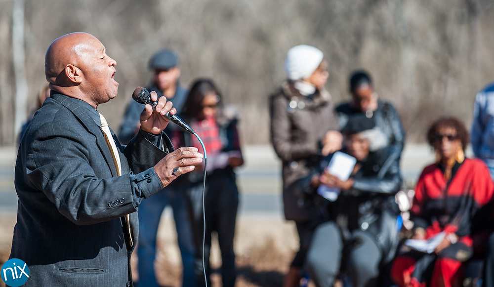 Rev. Willie Hicks sings during a wreath laying ceremony honoring the legacy of Dr. Martin Luther King Jr. at the MLK Plaza in Concord Monday afternoon.