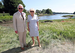 The Prince of Wales and Duchess of Cornwall (right) during a visit to Llangwm, in west Wales.