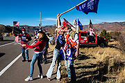 Karen Carner leans up to kiss her husband of seven years, Mark Lee, at a Trump rally on Highway 82 next to the Intercept Lot in Aspen, Colorado.