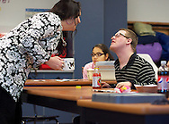 Jeremy Maccarrone shares a moment in class with Sparkle Coach and Challenge Program assistant Candy Erickson.
