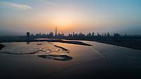 Aerial view of Dubai skyscrapers at sunset, United Arab Emirates.