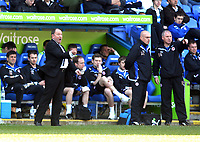© Andrew Fosker / Richard Lane Photography 2010 -  Peterborough's manager Gary Johnson (L) screams at his players during their 6 - 0 defeat as Reading's manager Brian McDermott (2nd R) calmly discusses matters with one of his staff - Reading v Peterborough - Coca-Cola Championship - 17/04/2010 - Madejski Stadium - Reading - UK.