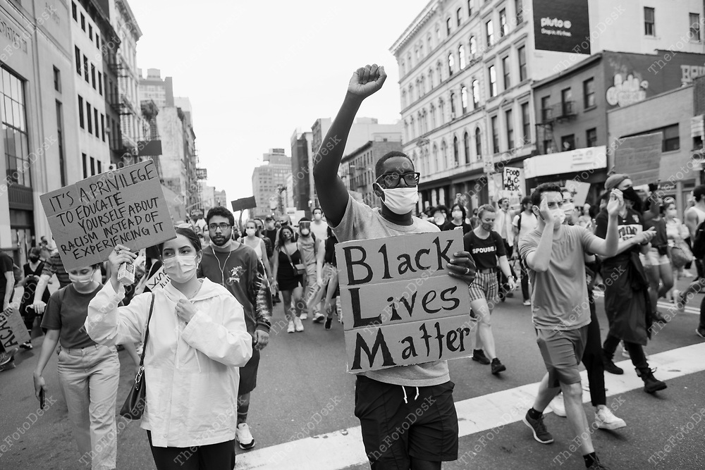 NEW YORK, NEW YORK:  BLM demonstrators take to the streets after a rally at Washington Square Park in New York on Thursday June 11, 2020. Day 17 since the killing of George Floyd by Minneapolis, Minnesota Police officer Derek Chauvin.  (Brian Branch-Price/TheFotoDesk.)