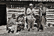 Four Mountain Men sharing stories in front of the outpost in Historic Fort Bridger in southern Wyoming.