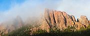Granite rock spires in clouds above McMurdy Park, Lost Creek Wilderness, Colorado.