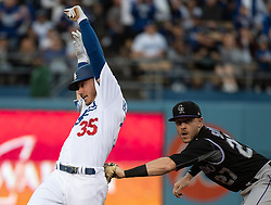 May 22, 2018 - Los Angeles, CA, U.S. - LOS ANGELES, CA - MAY 22: Los Angeles Dodgers' Cody Bellinger (35), left, safely reaches second base before a tag by Colorado Rockies shortstop Trevor Story (27) during a Major League Baseball game between the Colorado Rockies and the Los Angeles Dodgers on May 22, 2018 at Dodger Stadium in Los Angeles, CA. (Photo by Kyusung Gong/Icon Sportswire) (Credit Image: © Kyusung Gong/Icon SMI via ZUMA Press)