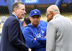 October 31, 2017 - Los Angeles, California, U.S. - Los Angeles Dodgers manager Dave Roberts, center, listens to former Los Angeles Dodgers pitcher Orel Hershiser, left, and former Brooklyn and Los Angeles Dodgers pitcher Don Newcombe prior to game six of a World Series baseball game at Dodger Stadium on Tuesday, Oct. 31, 2017 in Los Angeles. (Photo by Keith Birmingham, Pasadena Star-News/SCNG) (Credit Image: © San Gabriel Valley Tribune via ZUMA Wire)